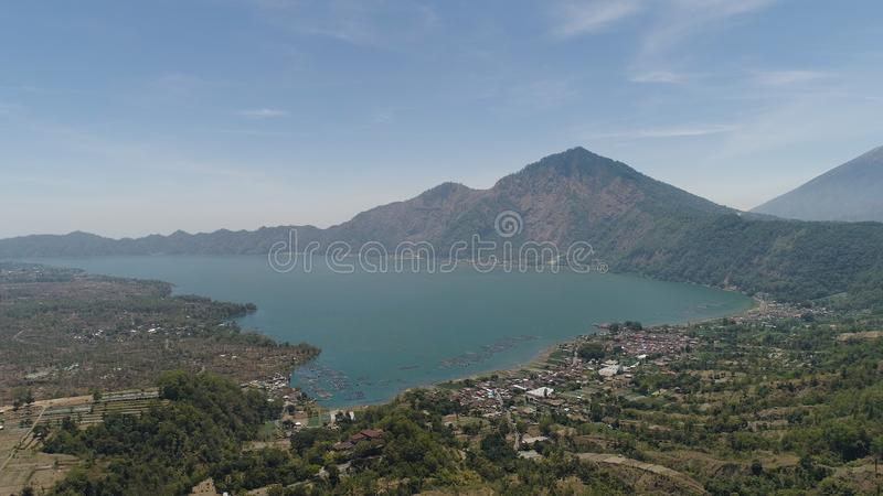 Mountain landscape lake and volcano Batur. Aerial view crater lake and volcano Batur mountain landscape with volcanoes, lake with sky and clouds Bali, Indonesia stock image
