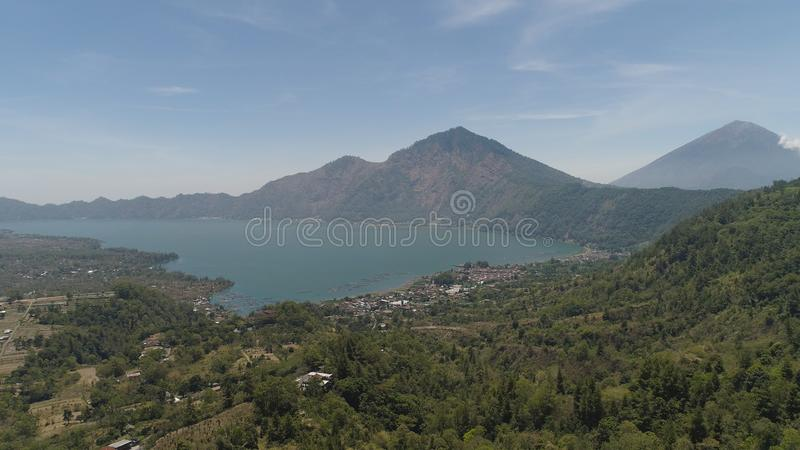 Mountain landscape lake and volcano Batur. Aerial view crater lake and volcano Batur mountain landscape with volcanoes, lake with sky and clouds Bali, Indonesia stock photo