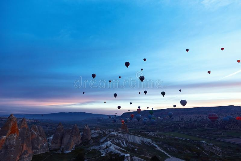 Mountain landscape with large balloons in a short summer season stock image