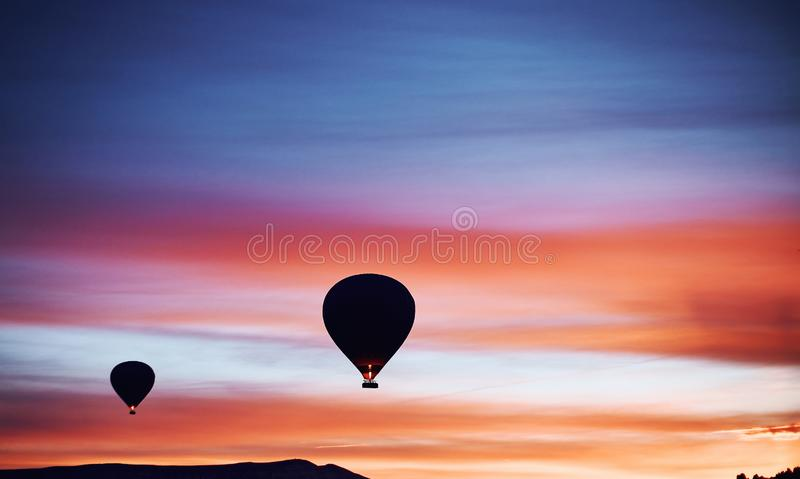 Mountain landscape with large balloons in a short summer season royalty free stock photo