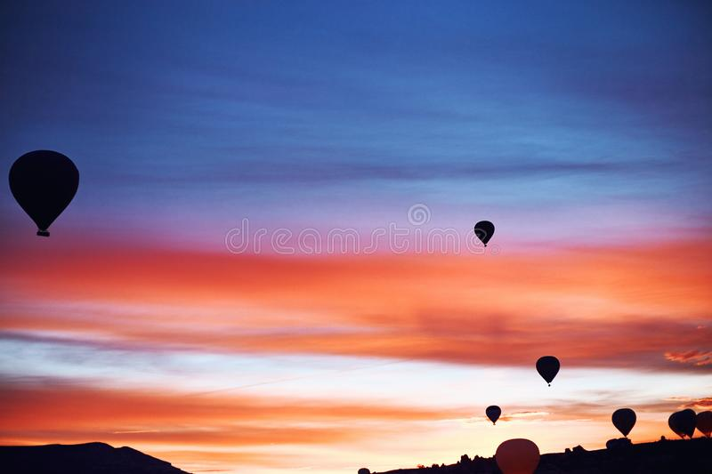 Mountain landscape with large balloons in a short summer season royalty free stock image