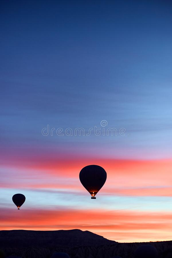 Mountain landscape with large balloons in a short summer season at dawn stock photo