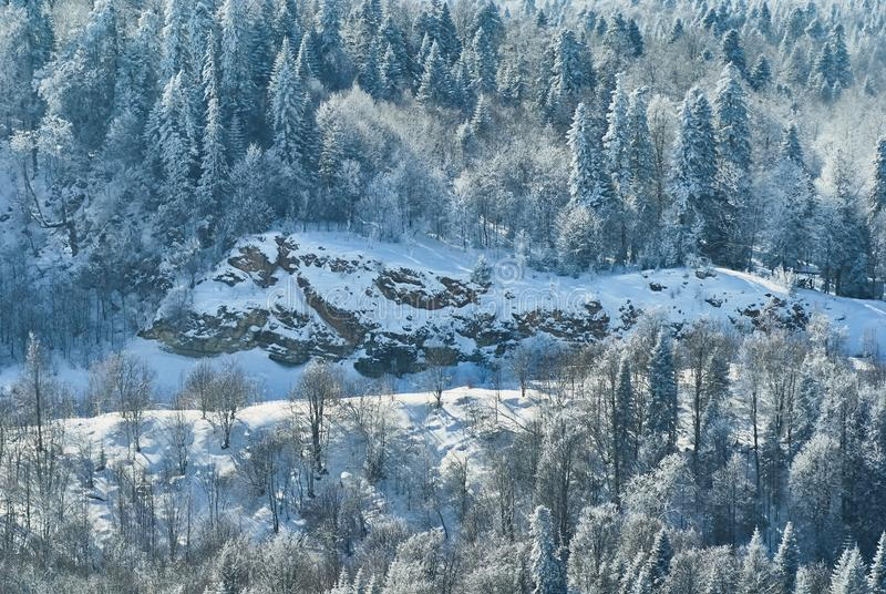 Mountain landscape. In the middle ground there is a rock, in the foreground and in the background there is a snow-covered forest. Lago-Naki, The Main Caucasian royalty free stock photos