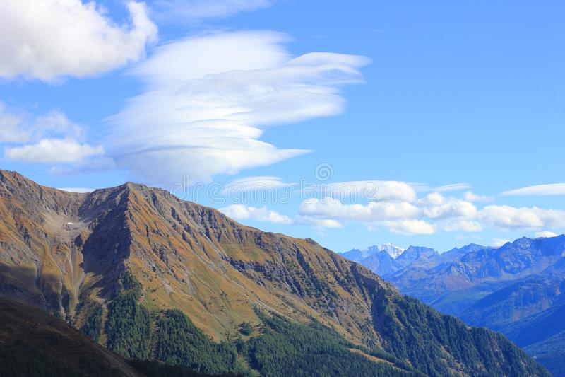 Mountain landscape and a panorama of clouds royalty free stock photo