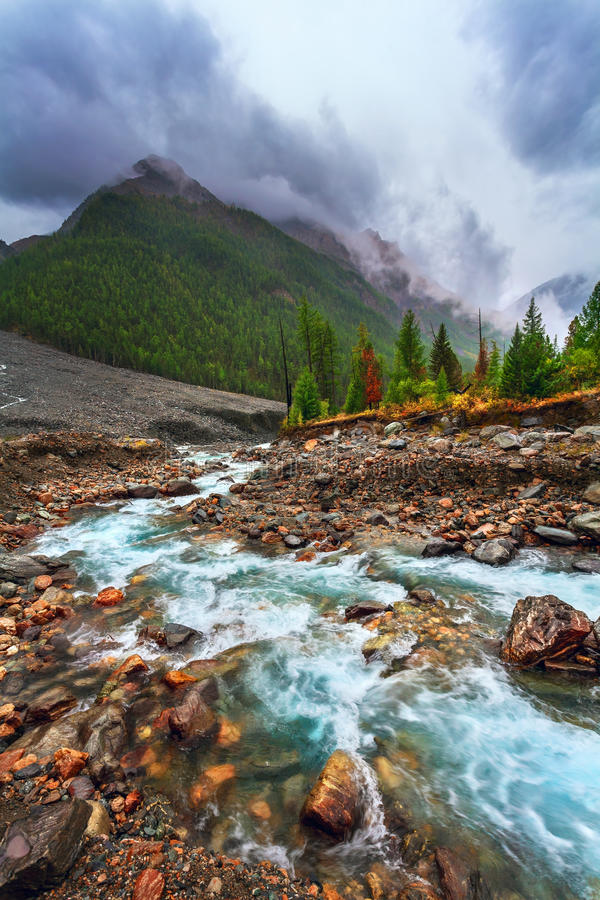 Mountain landscape with the river. Rainy gloomy weather royalty free stock photography