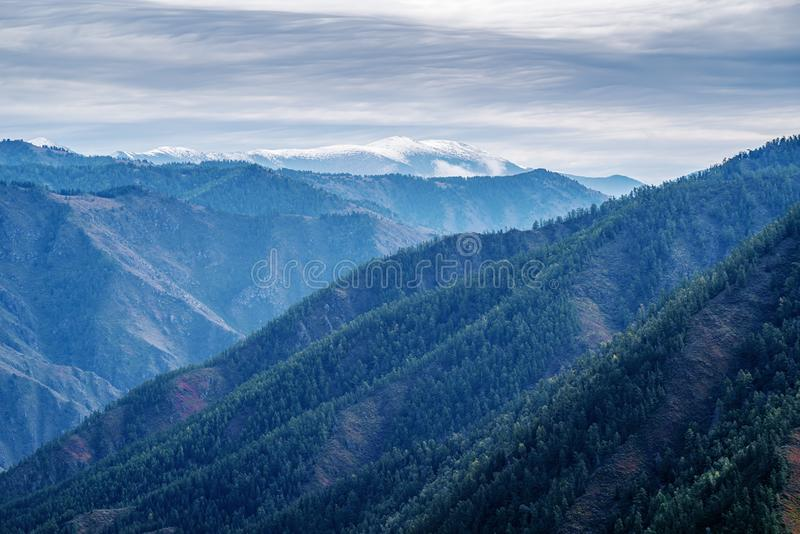 Mountain landscape with snowy peaks royalty free stock photography