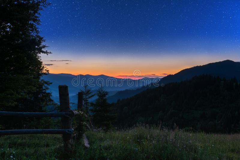Mountain landscape, starry summer night in alpine countryside royalty free stock image