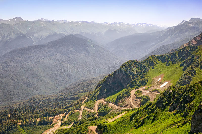 Mountain landscape: a winding road on the mountainside. stock photos