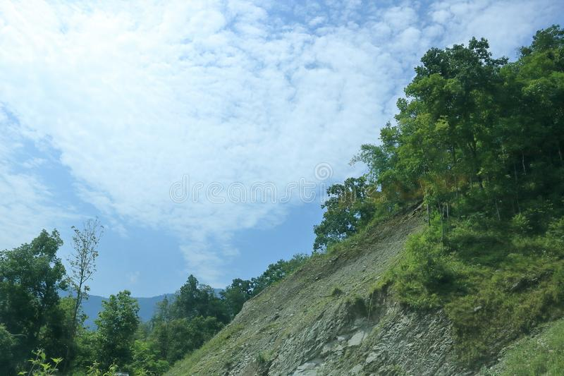 Mountain landscape on a sunny day with green plants and trees. In Sikkim, India royalty free stock image