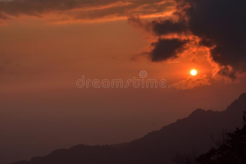 Mountain landscape at sunset at Bhutan Mountain. Amazing view on colorful clouds and layered mountains royalty free stock photography