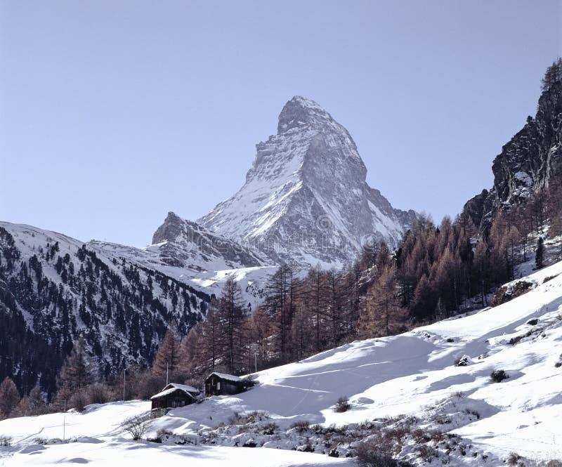Mountain Landscape Switzerland Wallis Zermatt Snow. Forest Border Chalets Mountains Sky royalty free stock photos