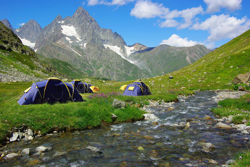 Mountain landscape with the tents. On the photo: mountain landscape with the tents royalty free stock photos