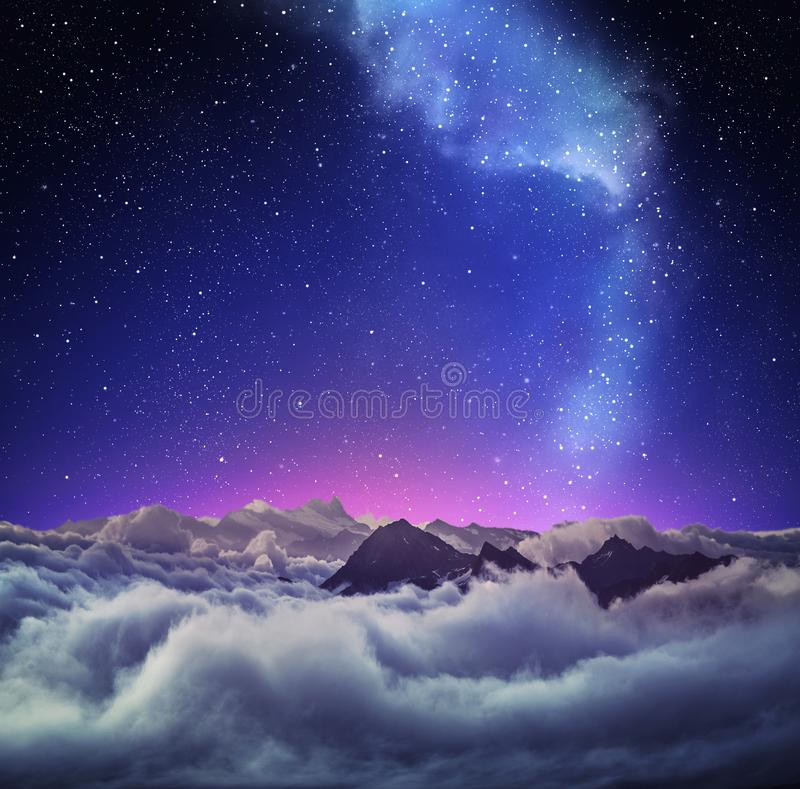 Mountain landscape under clear starry sky stock photography