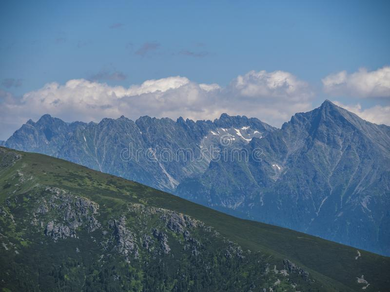 Mountain landscape of Western Tatra mountains or Rohace with view on high tatras with Krivan peak from hiking trail on stock photos