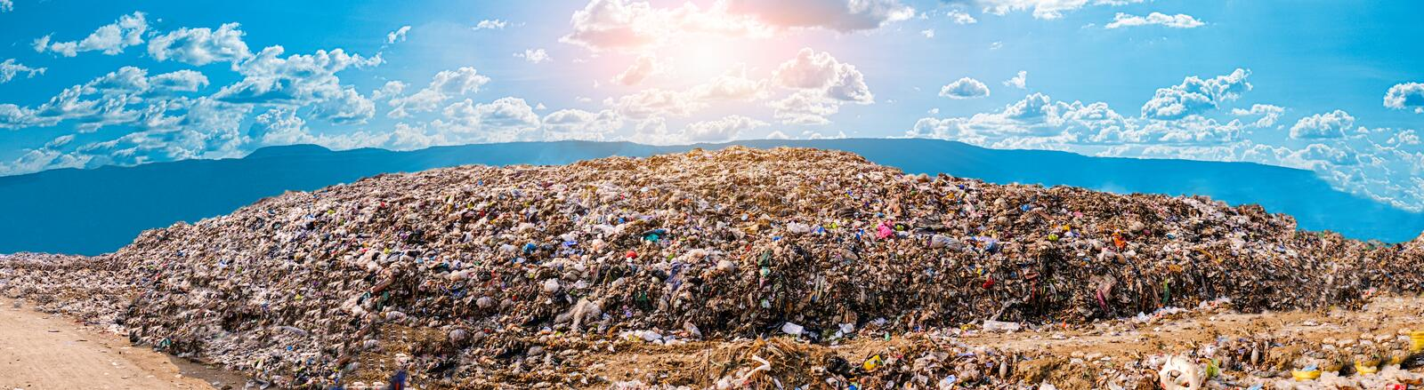 Mountain large garbage pile and pollution royalty free stock photo