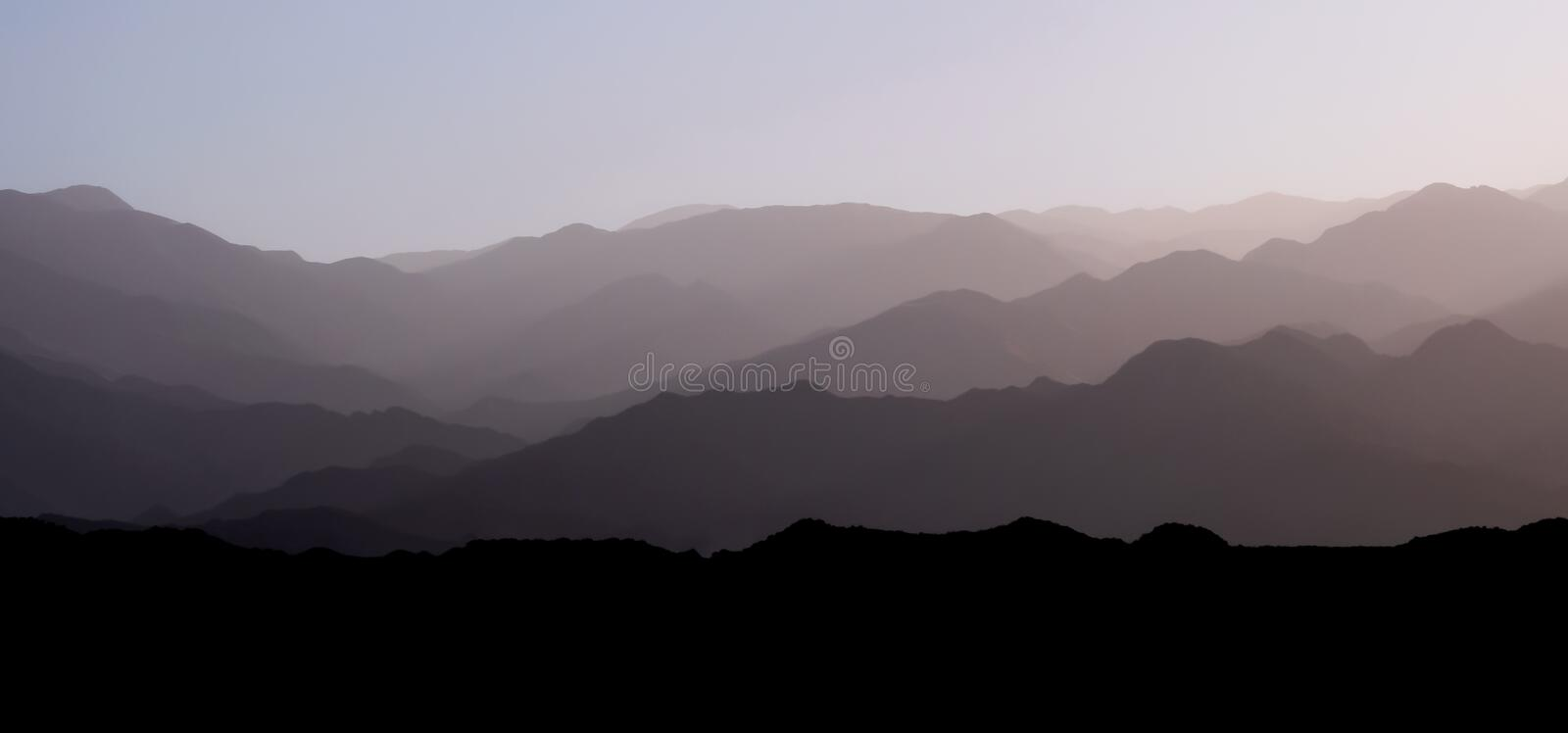 Mountain layers of the andean precordillera pre-mountain range and the cordillera at sunset, San Juan, Argentina stock images