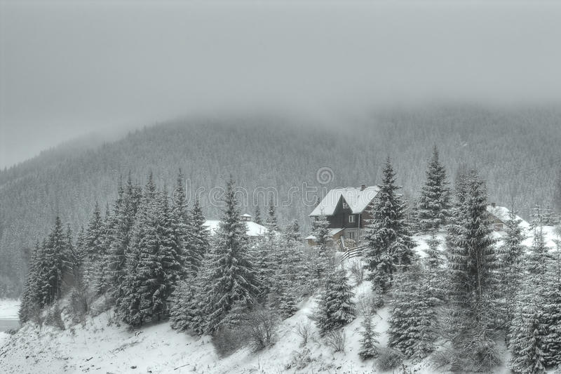Mountain lodge. In snowy landscape stock photography