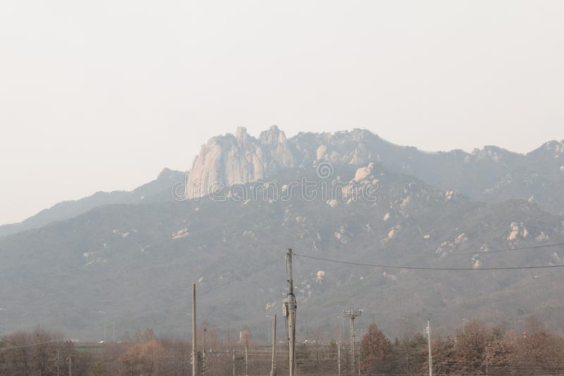 Mountain look blurred due to dense fine dust. Air pollution in Seoul stock photos