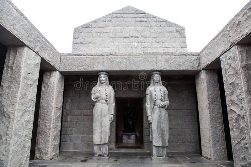 Two tall statues in the mausoleum of njegos stock photography