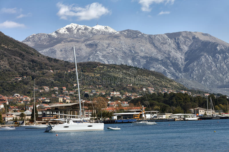 Mountain Lovcen peak and yacht stock images
