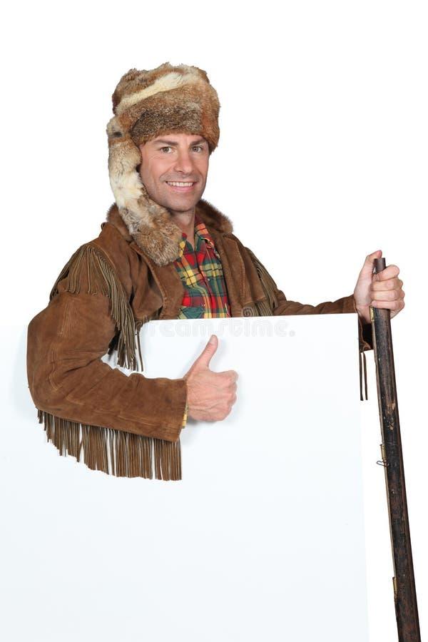 Mountain man holding a gun royalty free stock photos