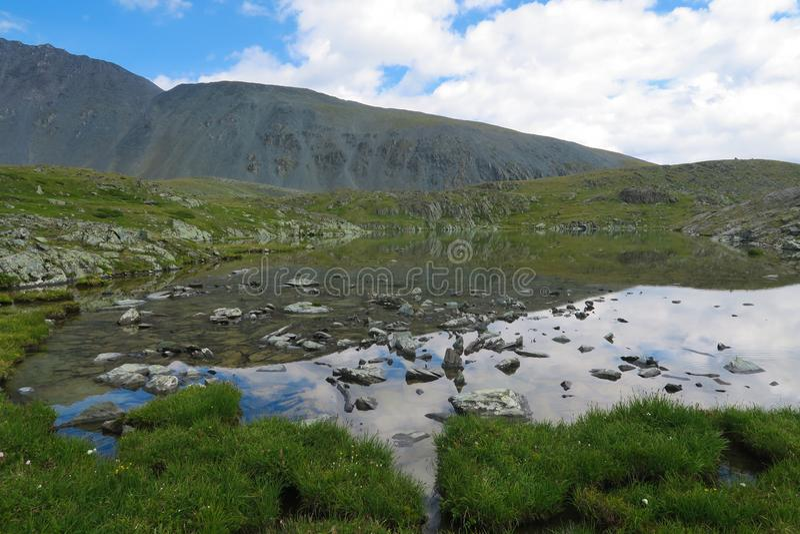 Mountain mirror clear lake. Valley of 7 lakes. Altai Mountains, Russia. Mountain mirror clear lake. Valley of 7 lakes. Altai Mountains stock photography