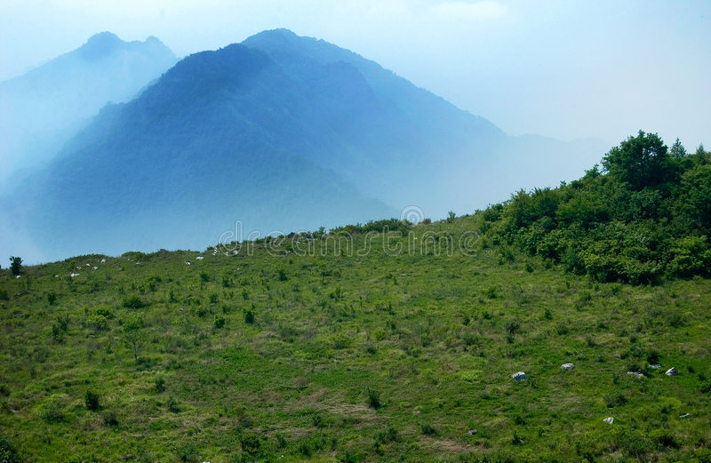 Mountain in mist stock photo