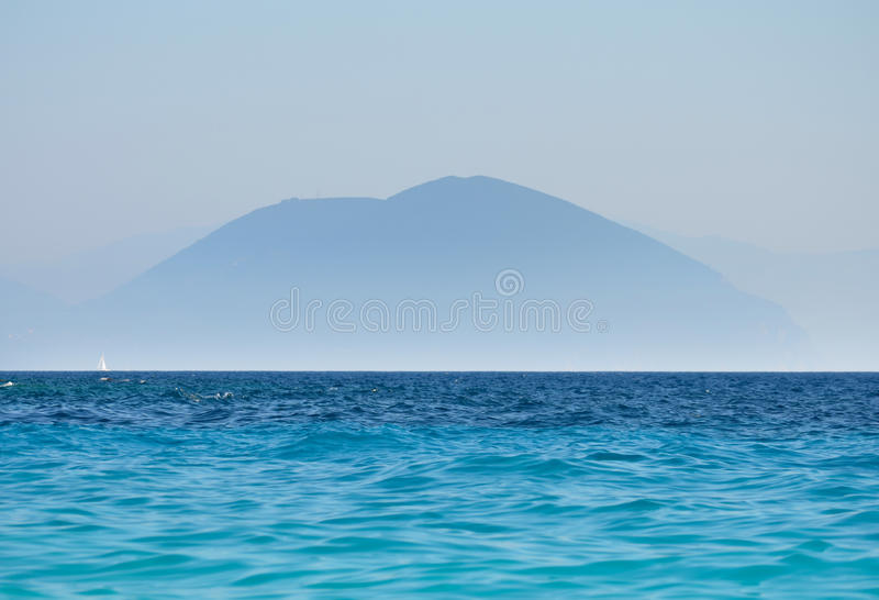 Mountain and ocean landscape blue silhouette of peaks stock photography