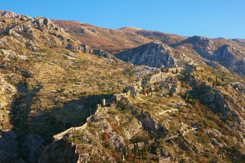 Mountain with the old fortifications and the road to Kotor fortress. Montenegro royalty free stock image