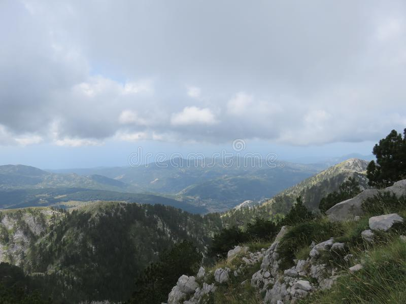 Mountain Orjen Montenegro rocky landscape green valley. Seen from the hiking trail in summer 2019 stock photography