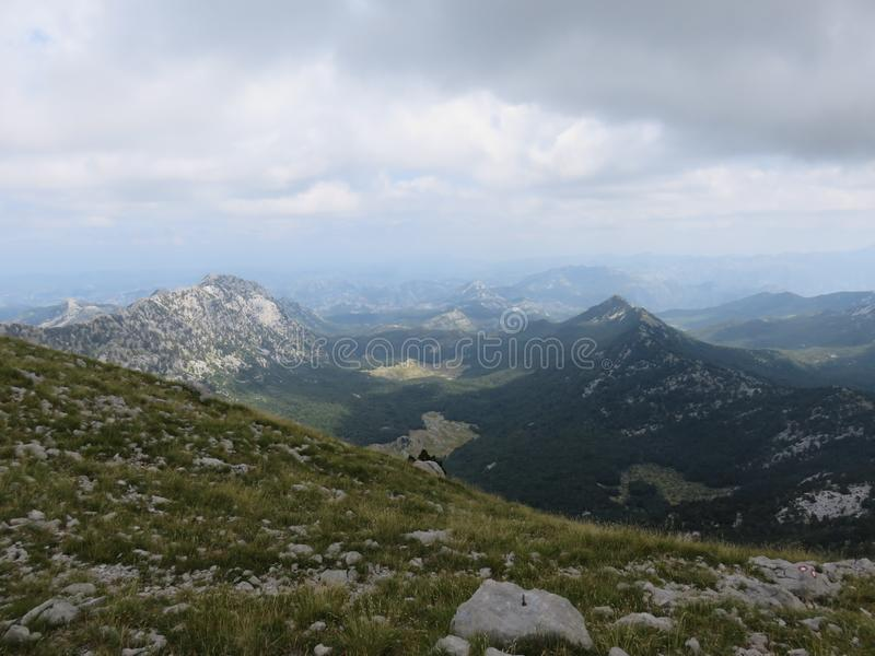 Mountain Orjen Montenegro rocky landscape green valley. Seen from the hiking trail in summer 2019 royalty free stock images