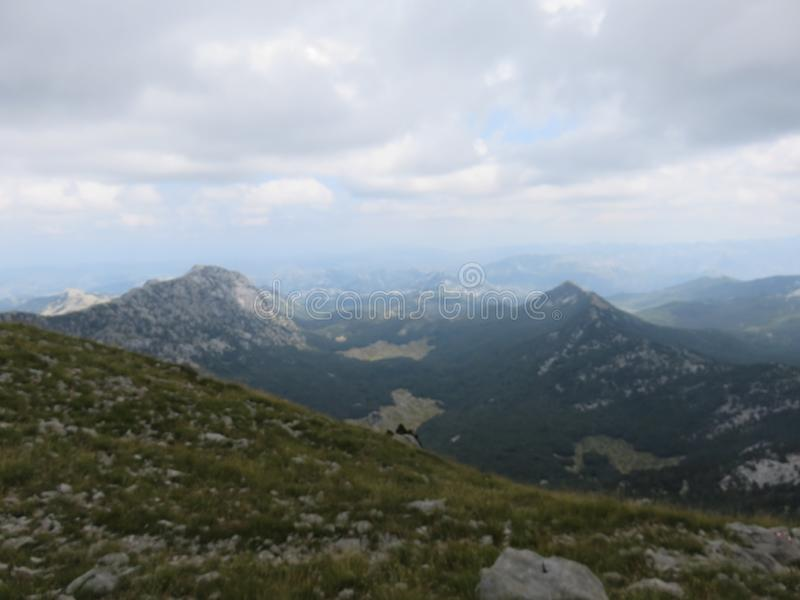 Mountain Orjen Montenegro rocky landscape green valley. Seen from the hiking trail in summer 2019 stock photo