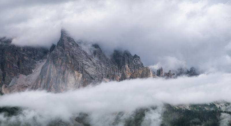 Mountain panorama in the Dolomite Alps, Italy. Mountain ridge in the clouds. royalty free stock images