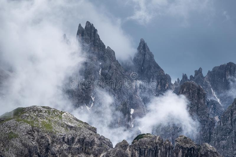 Mountain panorama in the Dolomite Alps, Italy. Mountain ridge in the clouds. royalty free stock photos