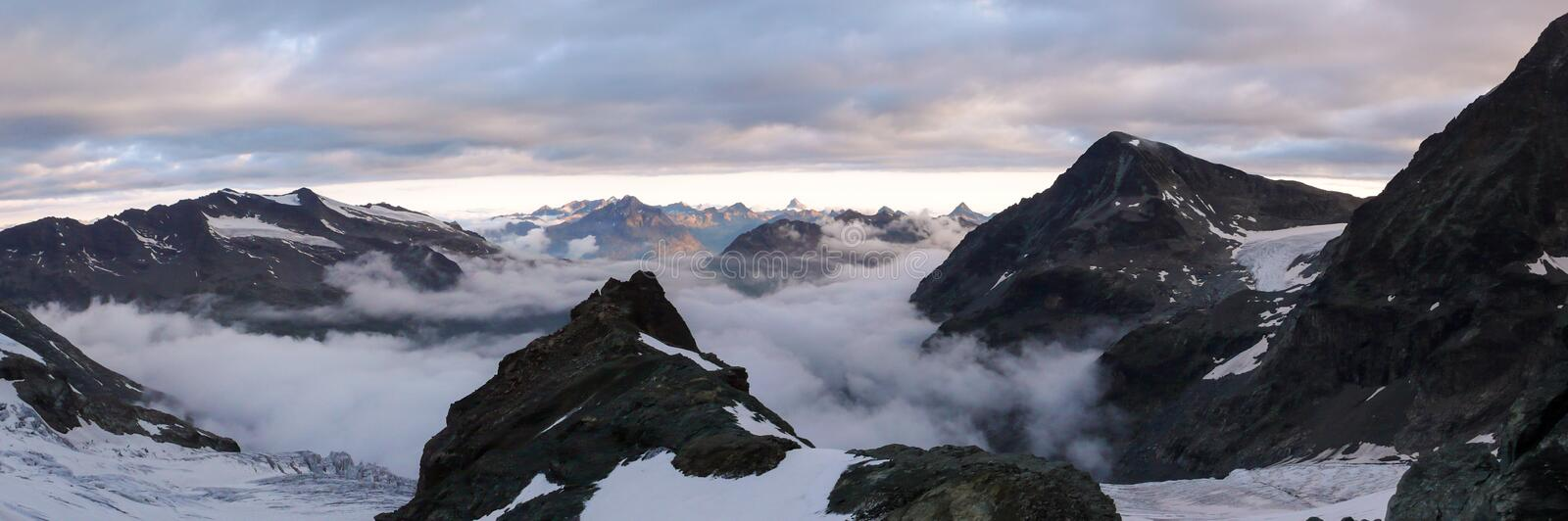 Mountain panorama landscape of the Bernina mountains and glaciers in the Swiss Alps near St. Moritz on a dark and ominous morning royalty free stock photo