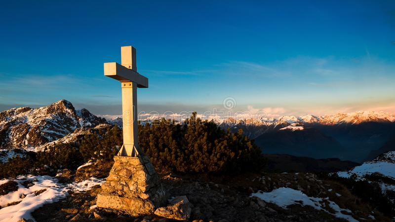 Mountain panorama from the summit where a cross is placed royalty free stock photo