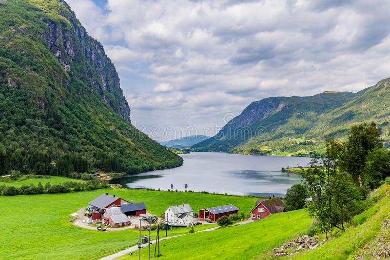 Landscape with farmhouse in Norway. Mountain panorama with typical Norwegian wooden farmhouse in Forde in Sogn og Fjorden county in Norway royalty free stock photography