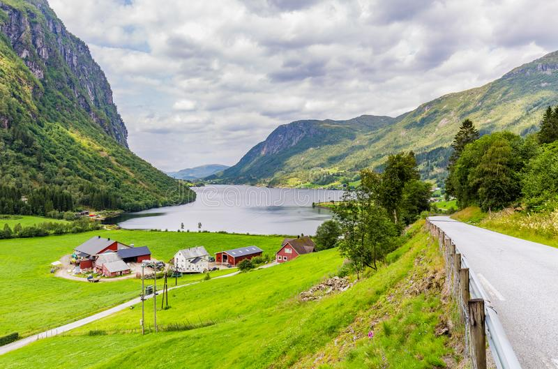 Landscape with farmhouse in Norway. Mountain panorama with typical Norwegian wooden farmhouse in Forde in Sogn og Fjorden county in Norway stock image
