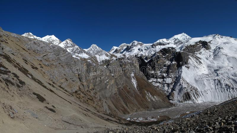 Mountain panorama on the way to the Thorung La Pass. View of Chulu West, Purbung Himal and several other high mountains. Photo taken near Thorung La Pass, famous royalty free stock photography