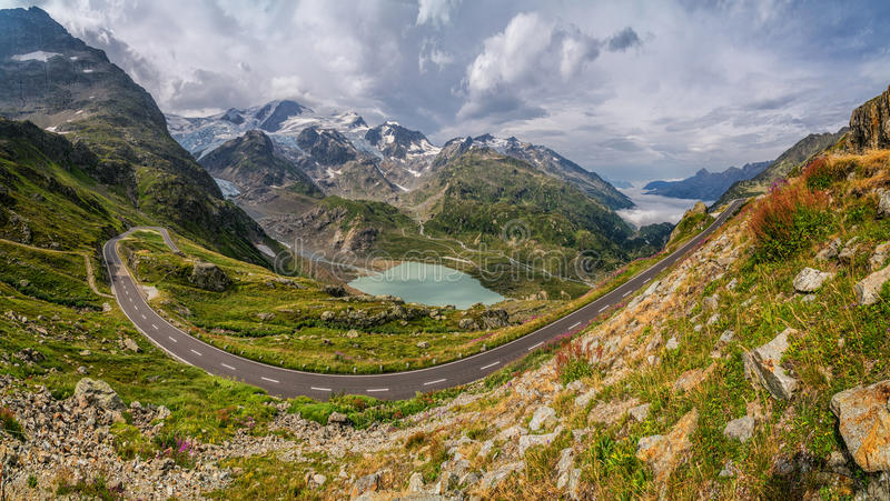 Mountain pass road in gorgeous alpine scenery in summer stock images