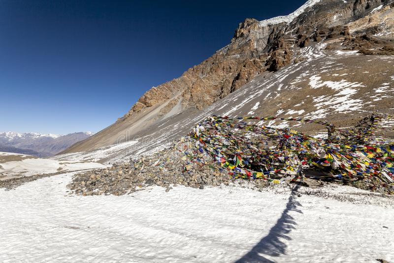 Mountain pass Thorong La Pass 5416 m, Annapurna Trek, Himalayas. Prayer buddhist flags fluttering in the wind stock photography