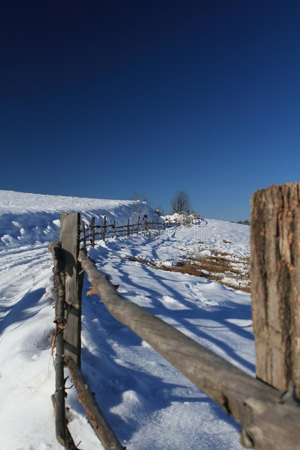 Mountain path and fence in winter stock photos