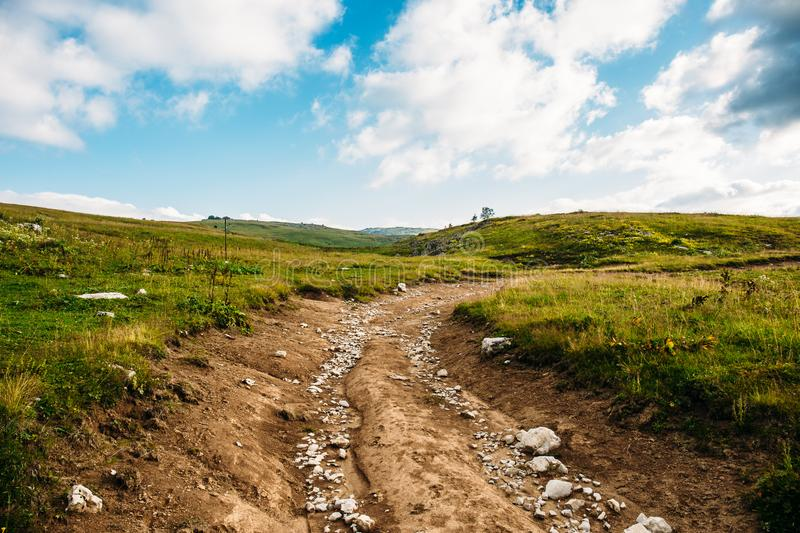 Mountain path or road in valley in Lago - Naki mountains. Hiking concept stock photography