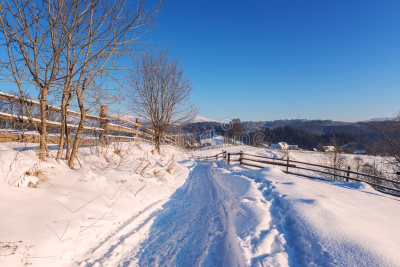 Mountain path in the snow, beautiful winter landscape with blue sky royalty free stock photography