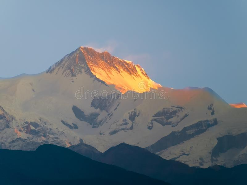 Mountain peak Annapurna II at sunrise, Himalayas, Nepal royalty free stock photos