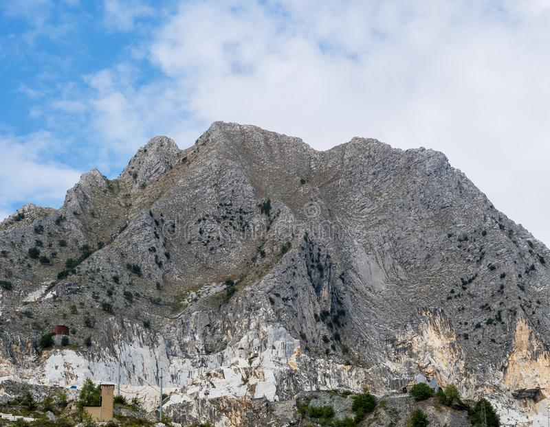 Mountain peak in the Apuan Alps, Italy, showing marble quarries at base. Mountain peak in the Apuan Alps, Italy, showing marble quarries at foot royalty free stock photography