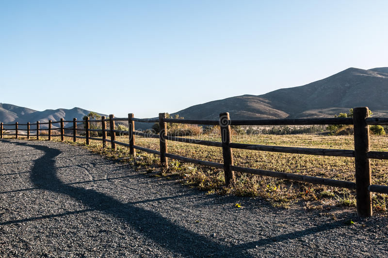Mountain Peak, Fence and Pathway in Chula Vista. Mountain peak, fence, and pathway in Chula Vista, California royalty free stock photography