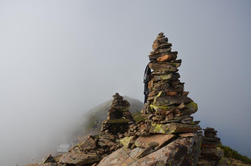 Mountain peak fog rocks moss stock images