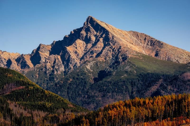 Mountain peak Krivan in High Tatras, with beautiful autumn color, Slovakia stock images