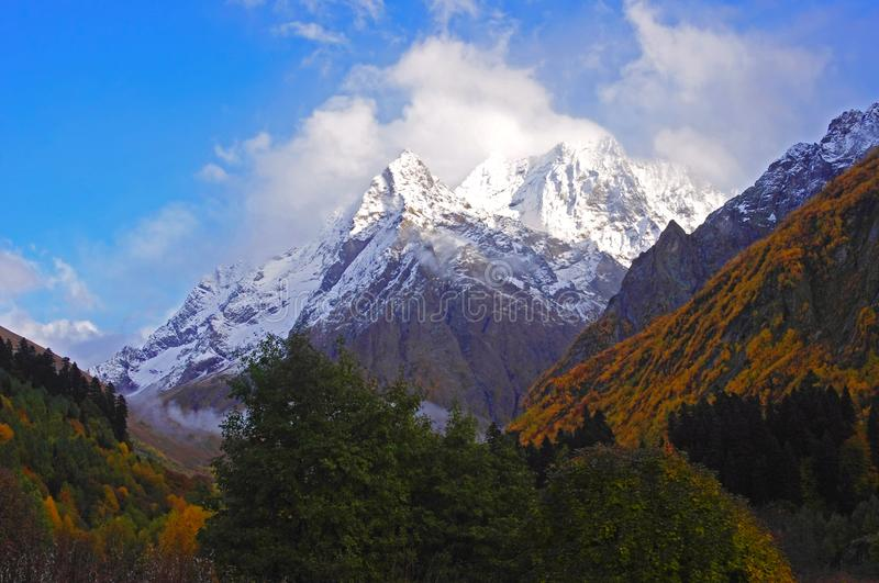 Mountain peak and landscape of the golden autumn in the mountains. Of Dombay stock photos